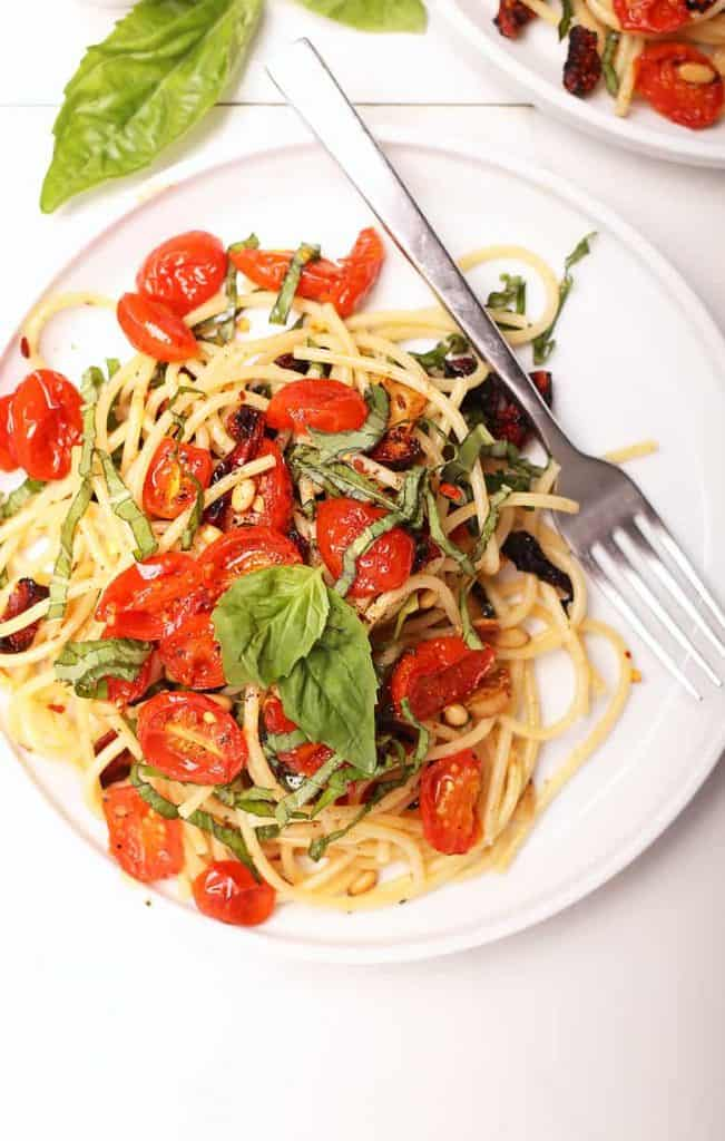 One plate of vegan pasta with cherry tomatoes