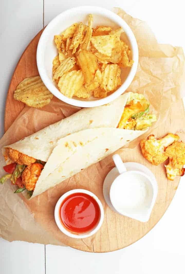 Buffalo Cauliflower Wrap on wooden platter