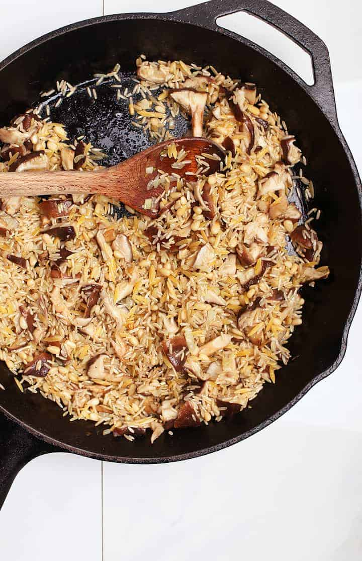 Uncooked Rice Pilaf in cast iron skillet
