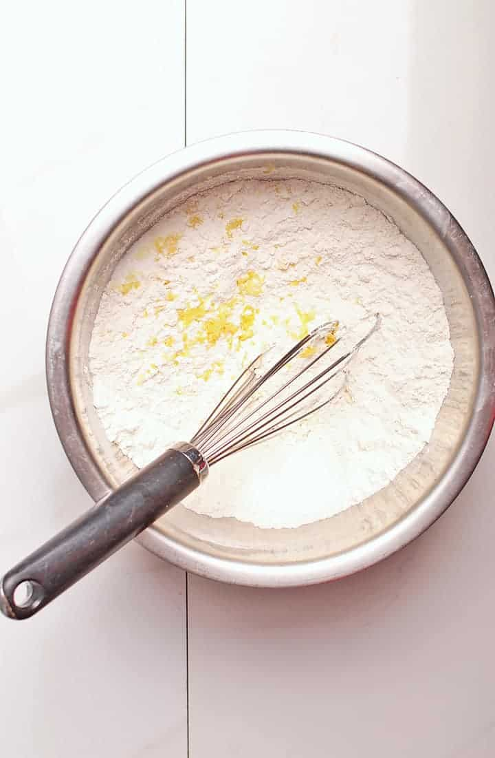 Flour and lemon zest in a bowl