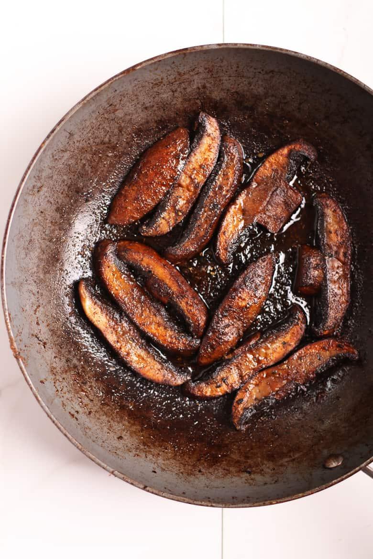 Sautéed portobello in a fry pan