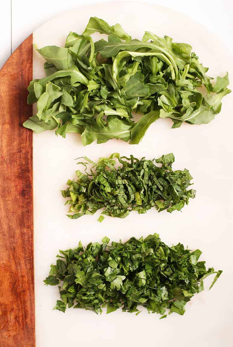 Chopped arugula, mint, and parsley