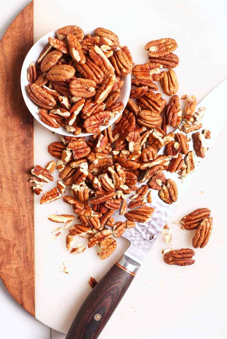 Chopped pecans on cutting board