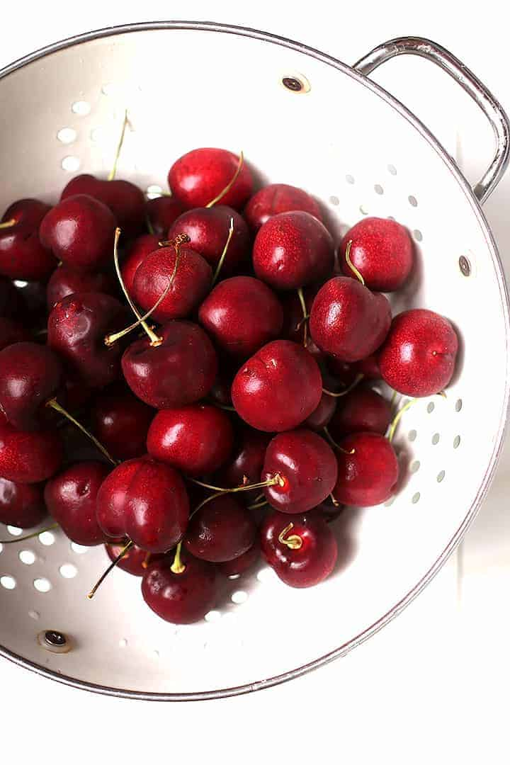 Bowl of fresh cherries in a colander
