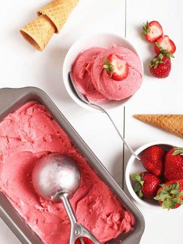 Strawberry ice cream on white background