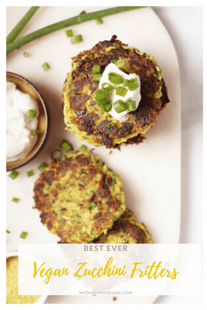 These warm and zesty vegan zucchini fritters! Made in just 20 minutes, they make the perfect breakfast, lunch, or dinner. Top with vegan sour cream and fresh green onions for a simple and delicious meal.