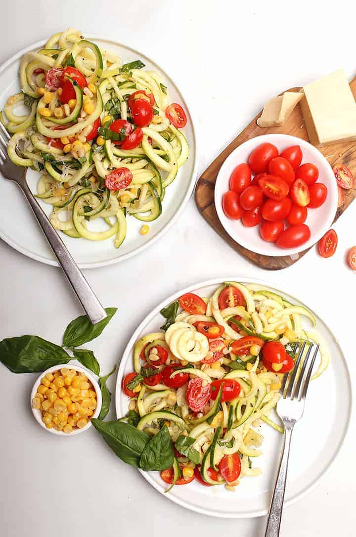 Zucchini salad on two white plates