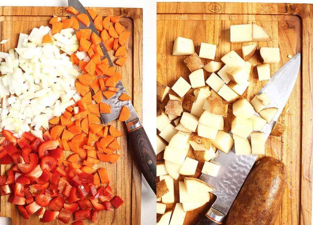 Chopped vegetables on a cutting board with a knife