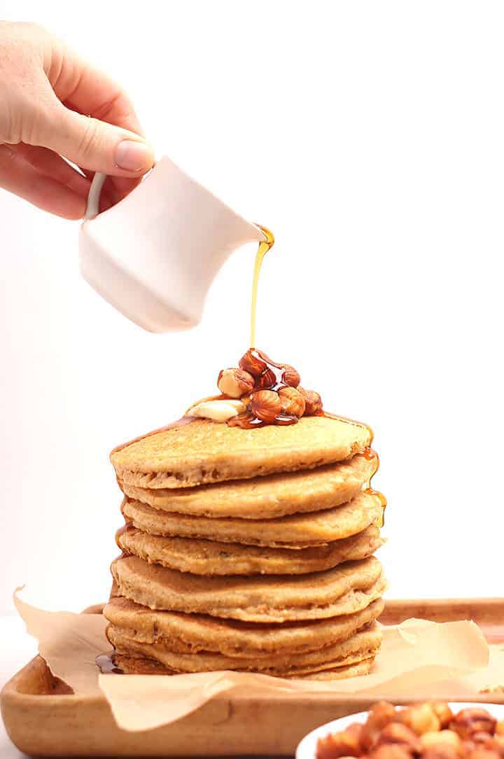 Stack of corncakes with maple syrup