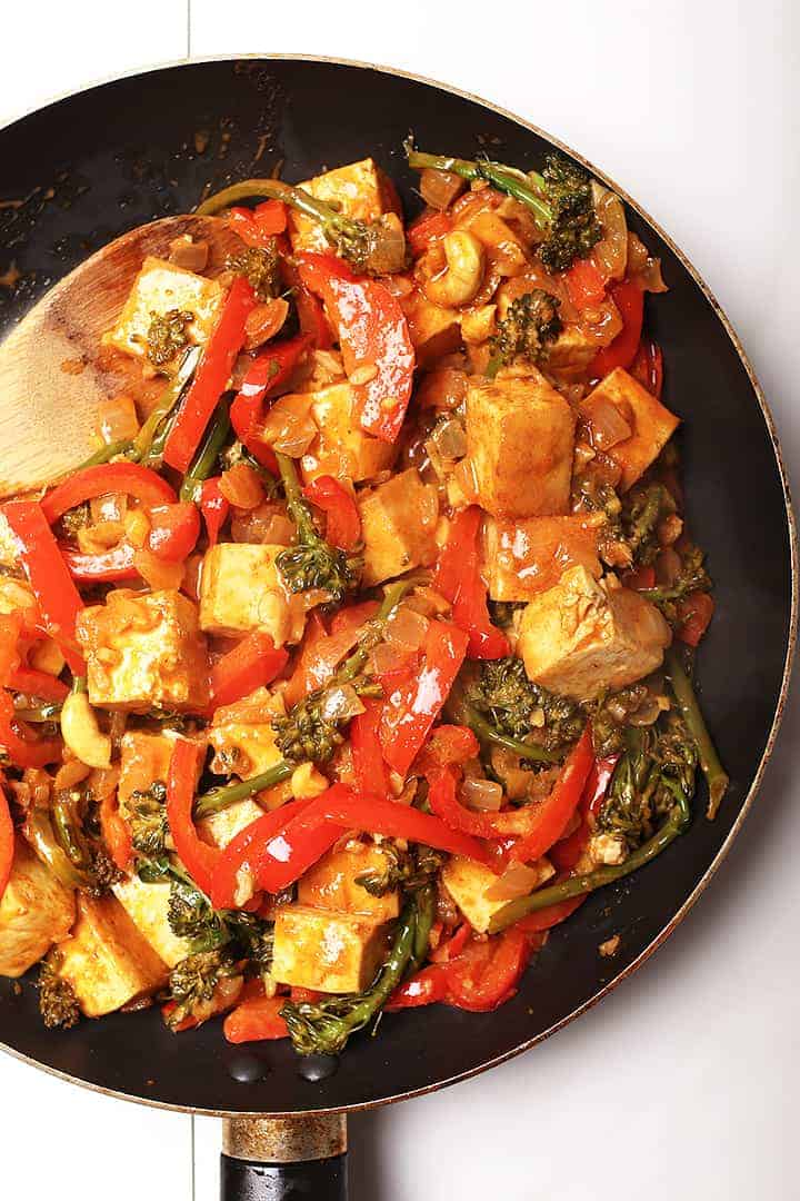 Sautéed tofu and vegetables in a skillet