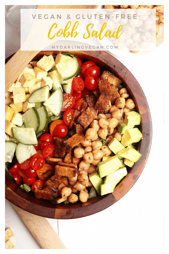 This Vegan Cobb Salad has it all! It is made with tempeh bacon, chicken-spiced chickpeas, eggy tofu, avocado, cucumber, and fresh tomatoes all served over a bed of fresh Romaine lettuce. Enjoy for a hearty lunch or light and refreshing dinner.