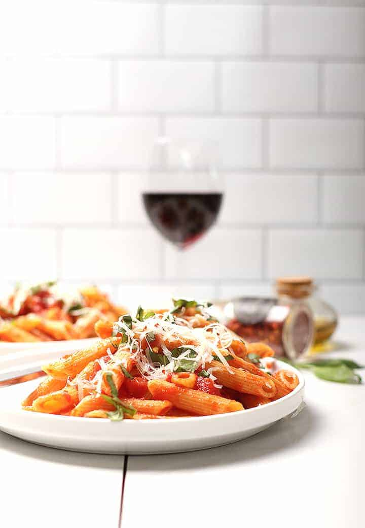 Pasta all'Arrabiata with glass of wine