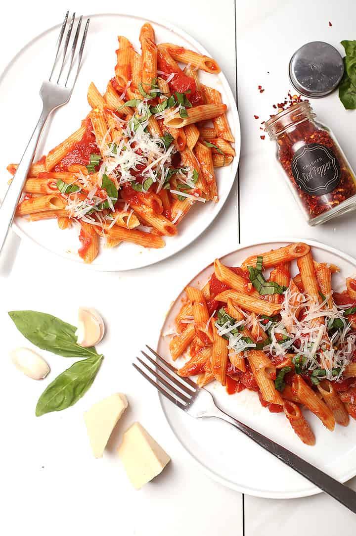 Pasta all'Arrabiata on two white plates