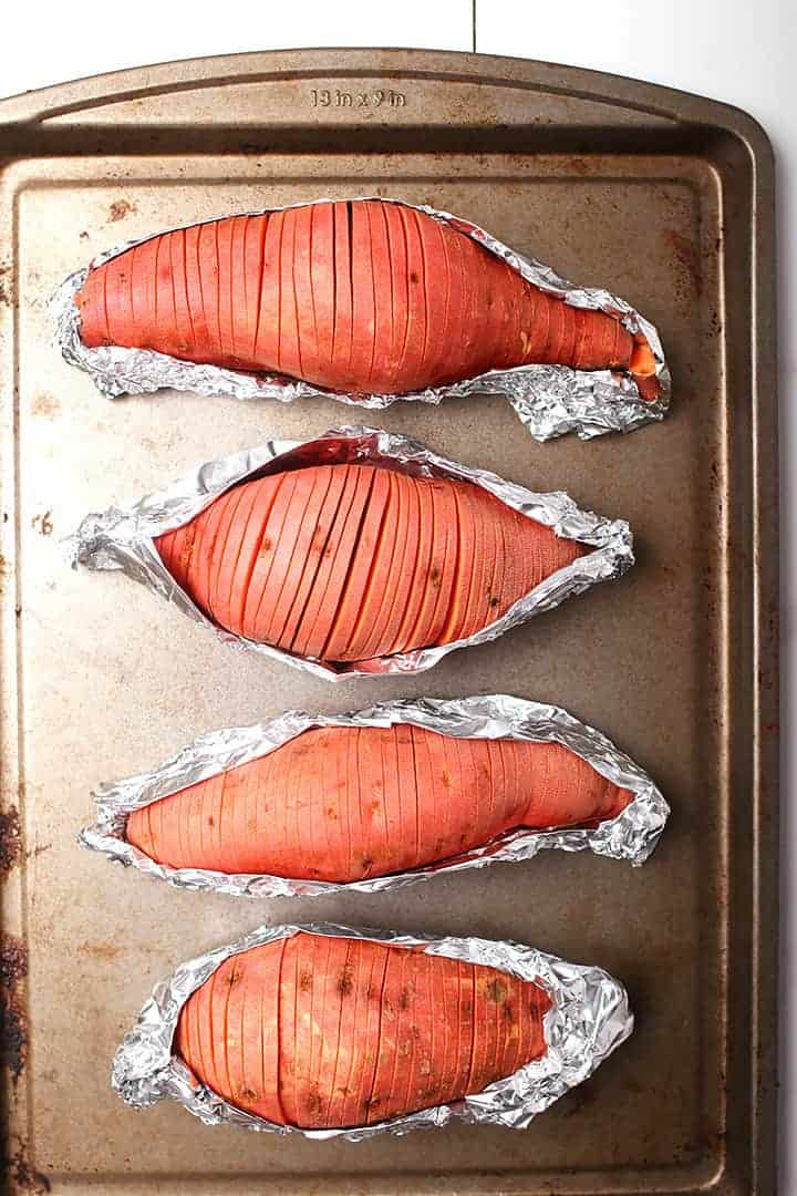 Hasselback sweet potatoes on baking sheet
