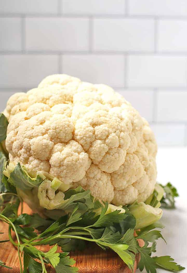 Head of cauliflower and fresh parsley