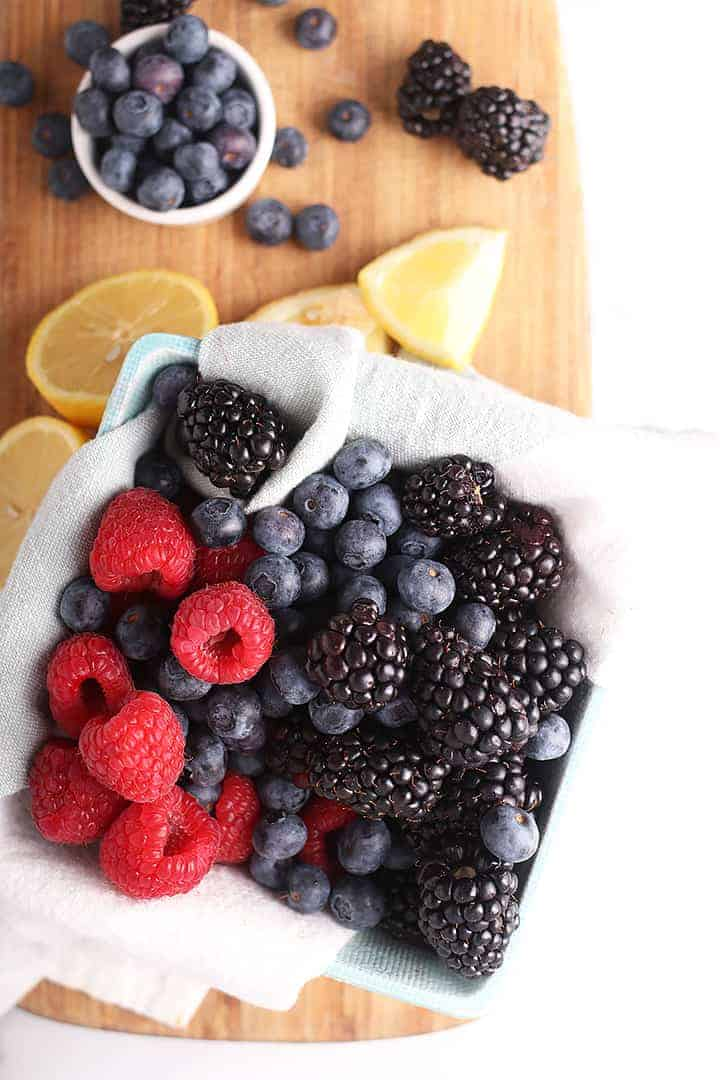 Mixed berries on a cutting board