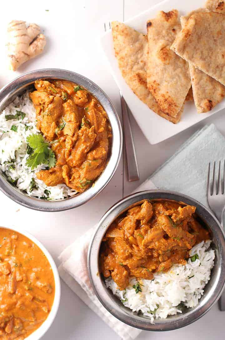 Two bowls of Tikka Masala served over rice