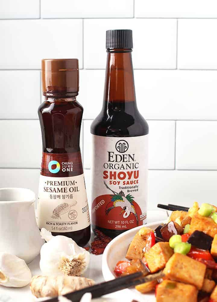 Two bottles of soy sauce and sesame oil