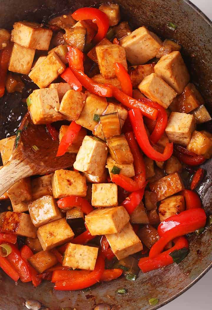 Cubed tofu and bell peppers in a skillet