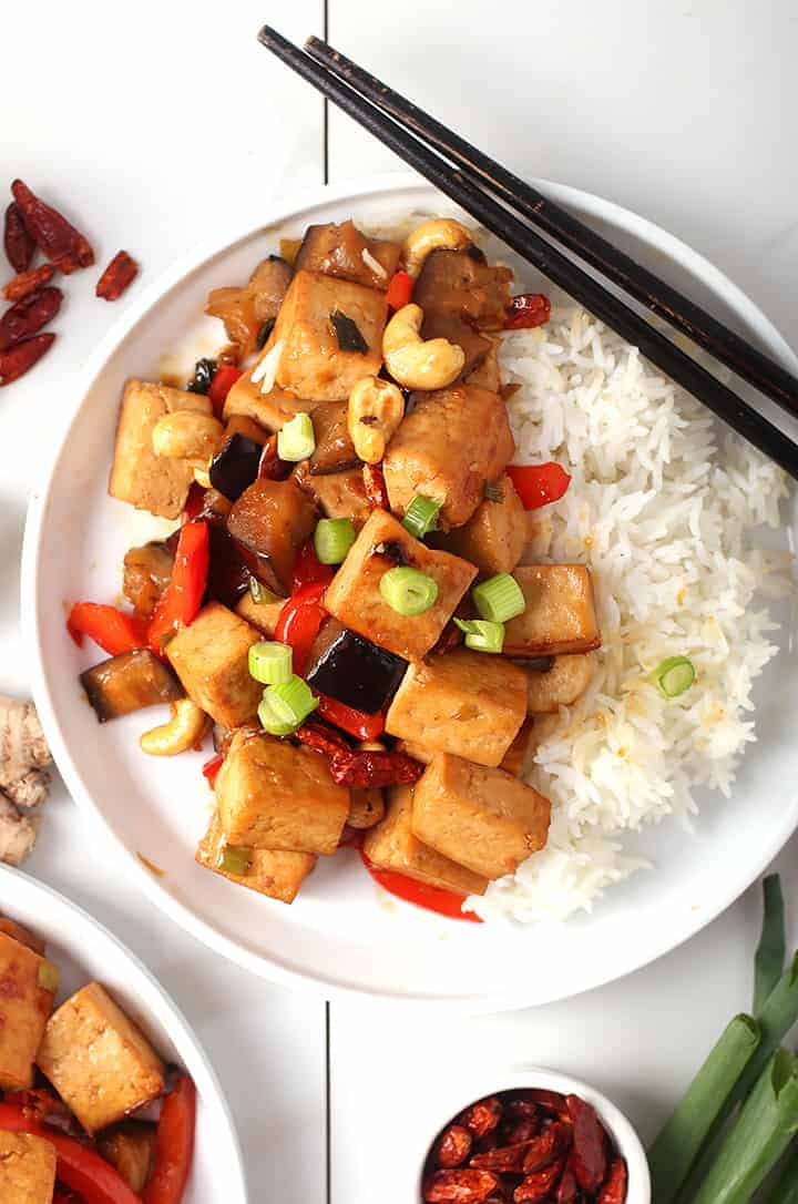 Kung Pao Tofu on white plate with rice