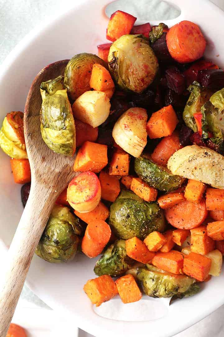 Roasted vegetables in a white serving dish