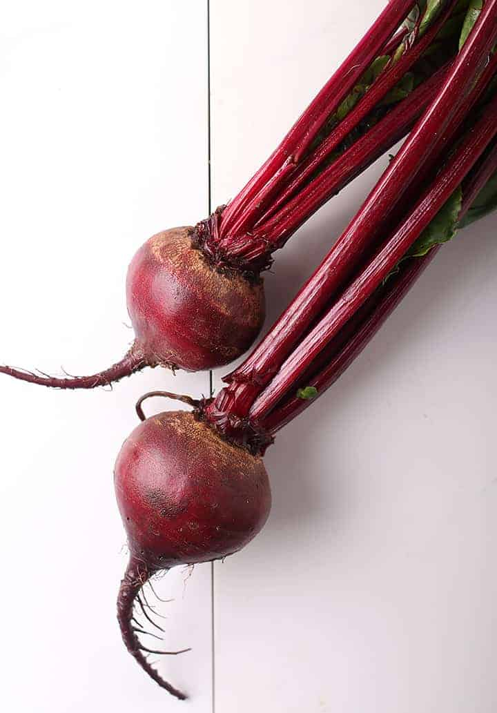 Two beets with stems