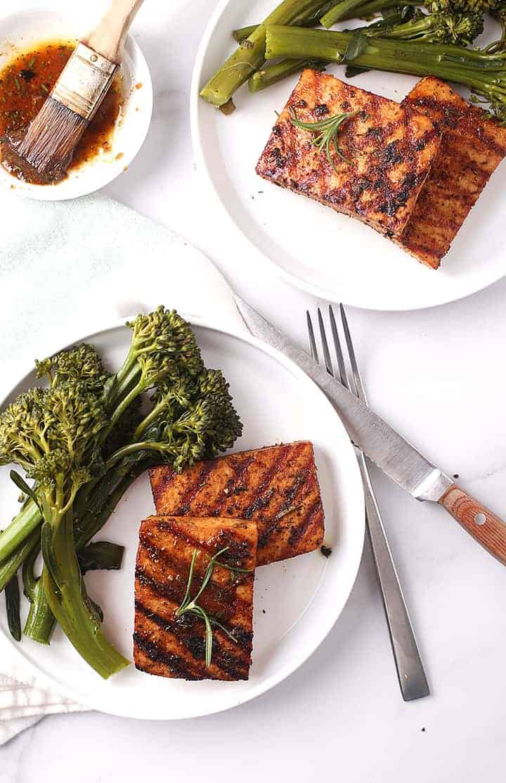 Two plates of Blackened Tofu Steaks with broccolini