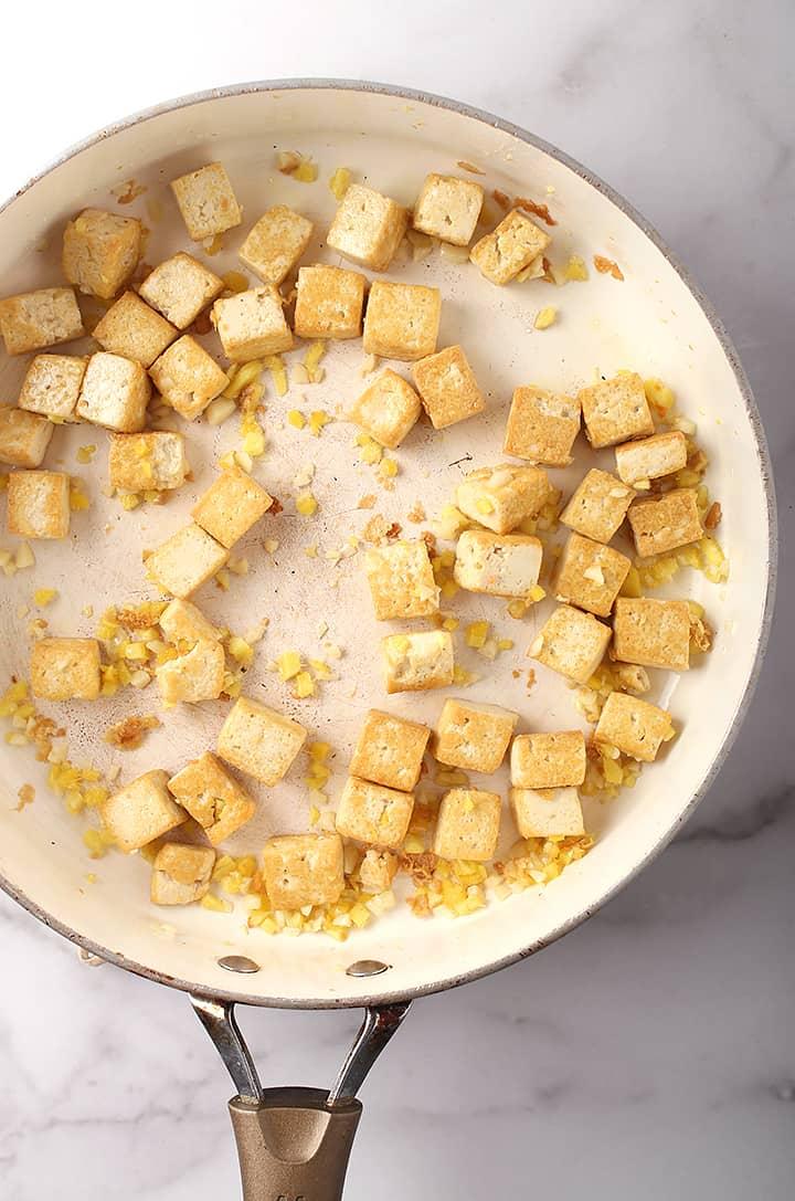 Tofu and garlic in a sauté pan