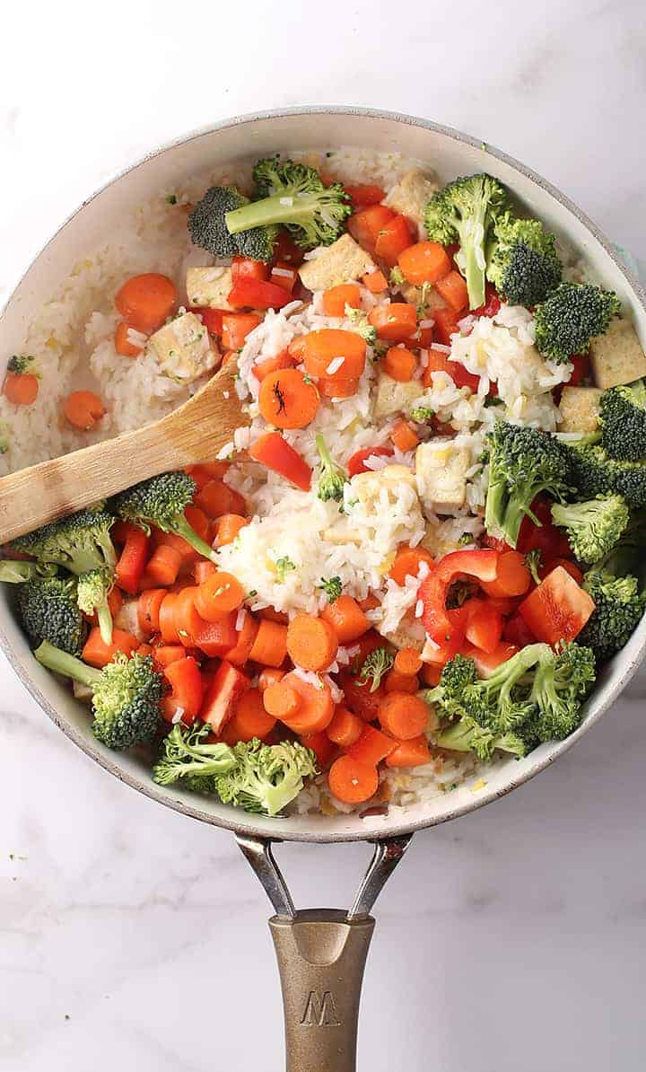 Rice and vegetables in a large sauté pan