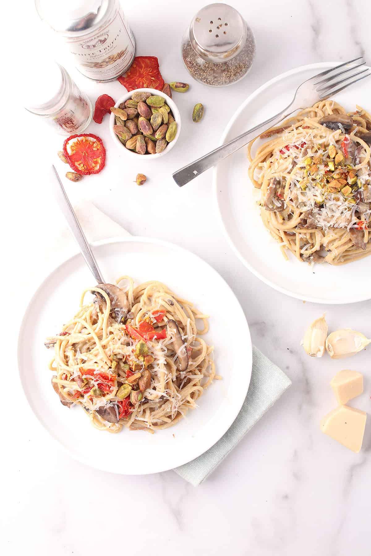 Truffle pasta on two white plates