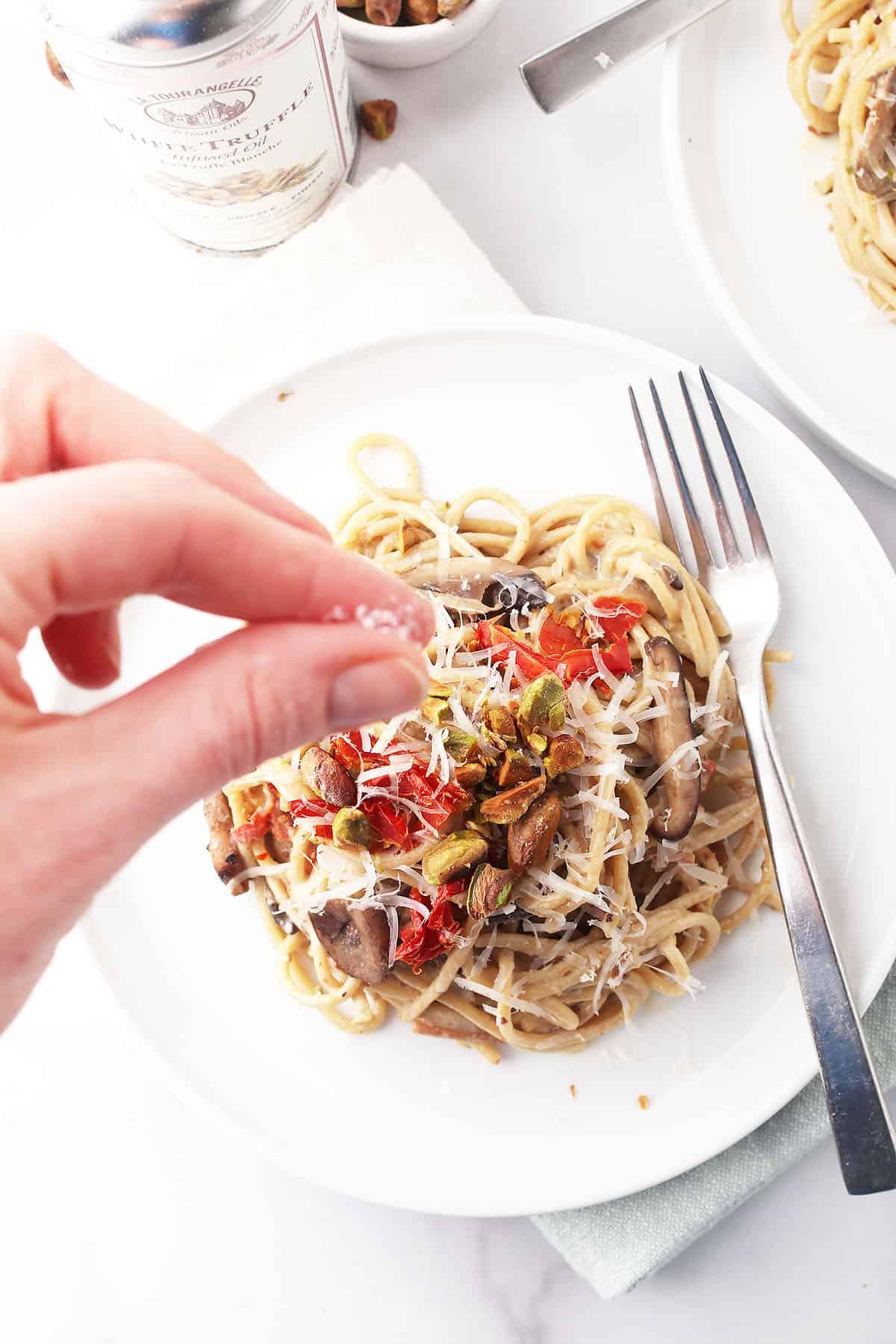 Truffle salt sprinkled on finished pasta