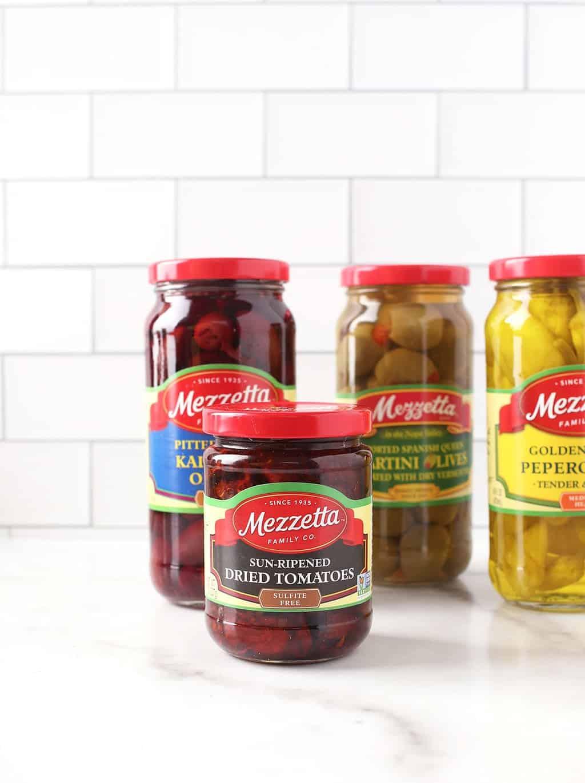 4 bottles of Mezzetta's olives and pickles