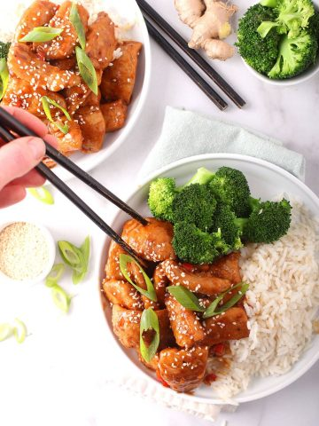 Finished recipe on a white plate with chopsticks