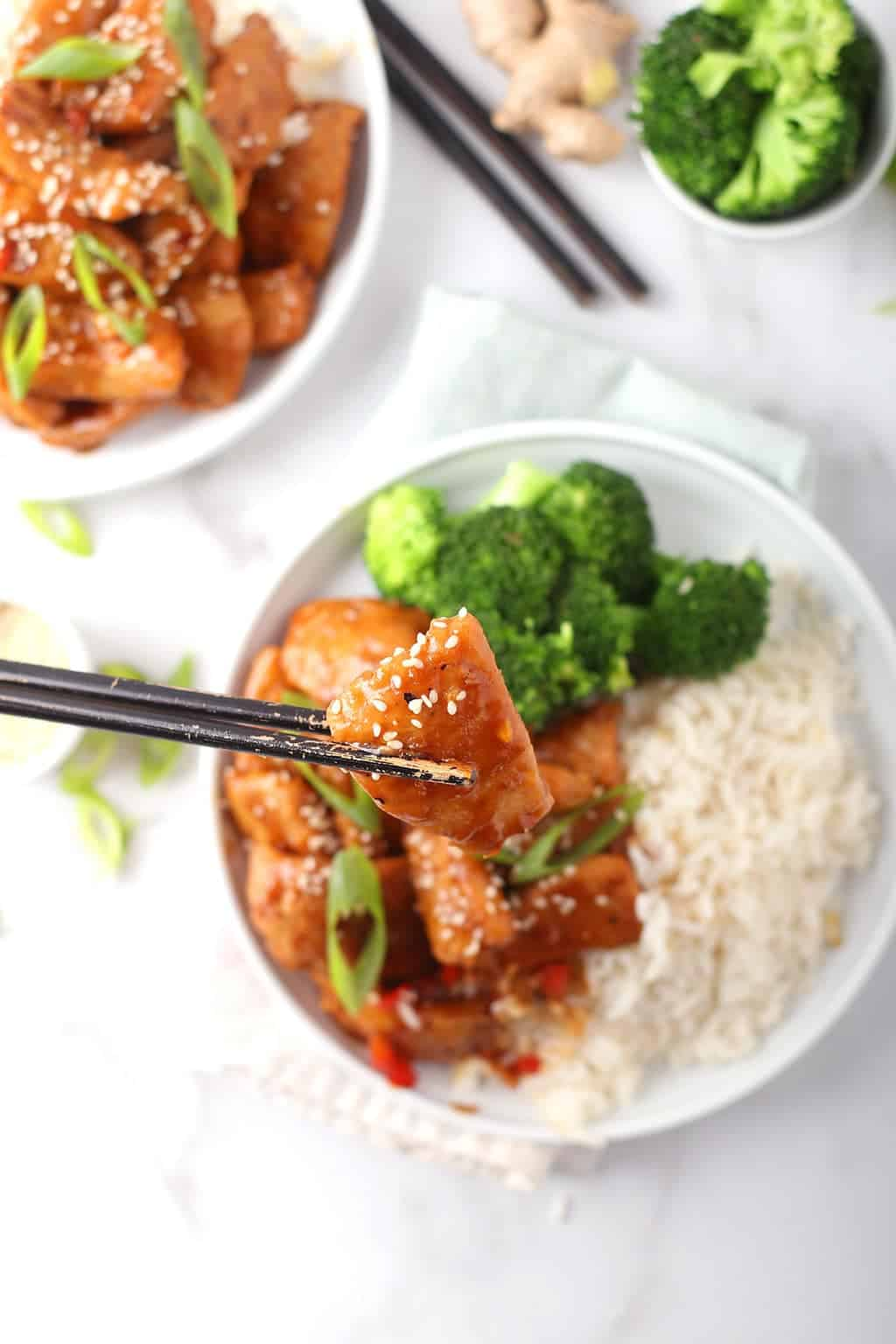 Vegan Mongolian Chicken on white plate with rice