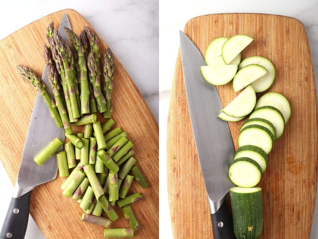 Sliced asparagus and zucchini on a cutting board