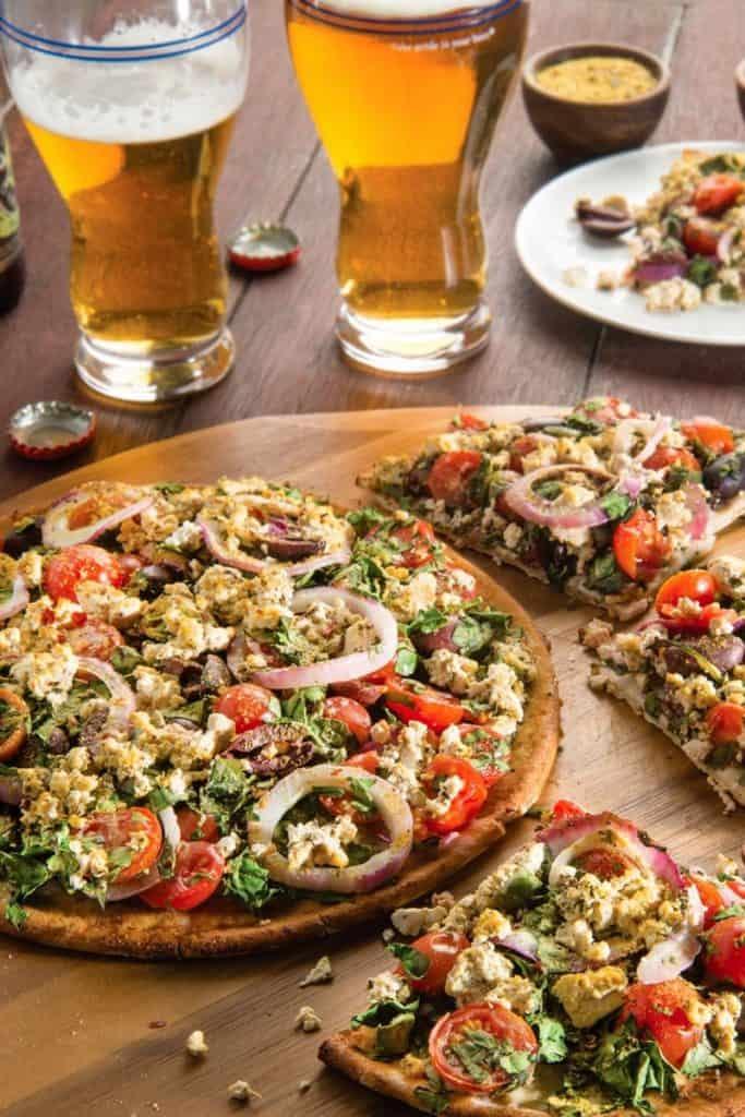 Greek Style Pizza on a wooden board