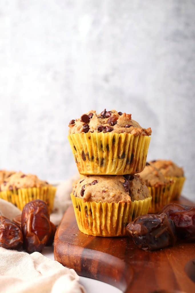 Two finished muffins stacked on top of one another