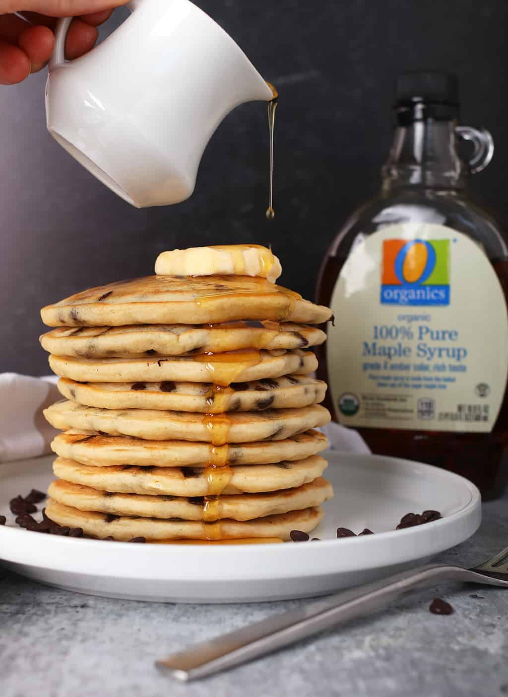 Stack of finished pancakes on a white plate