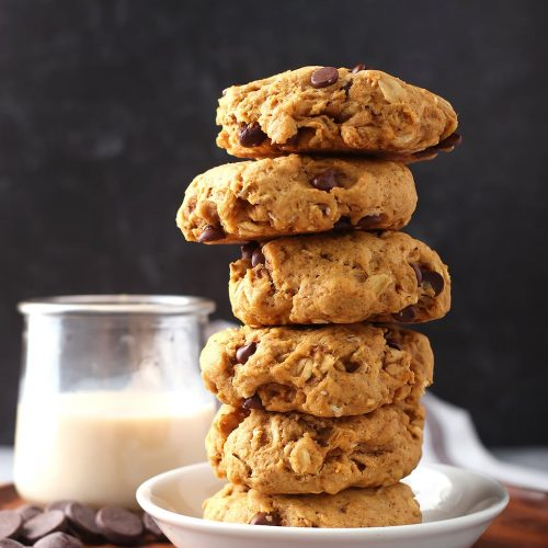 Stack of finished cookies next to a glass of milk