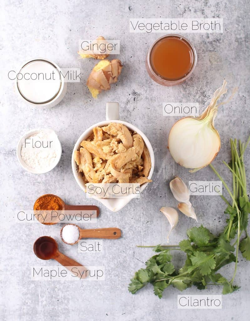 Ingredients for yellow curry on a concrete countertop