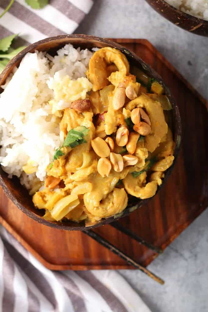 Finished dish served over rice in a coconut bowl
