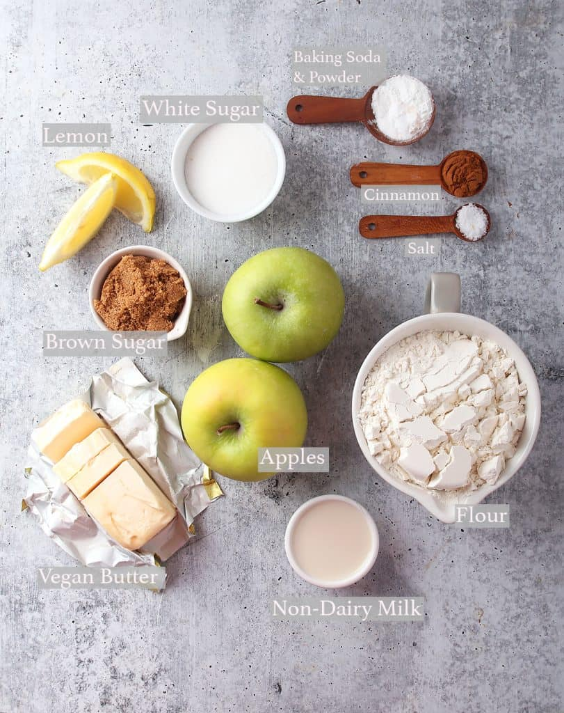 Ingredients for apple cobbler measured out and on a concrete countertop