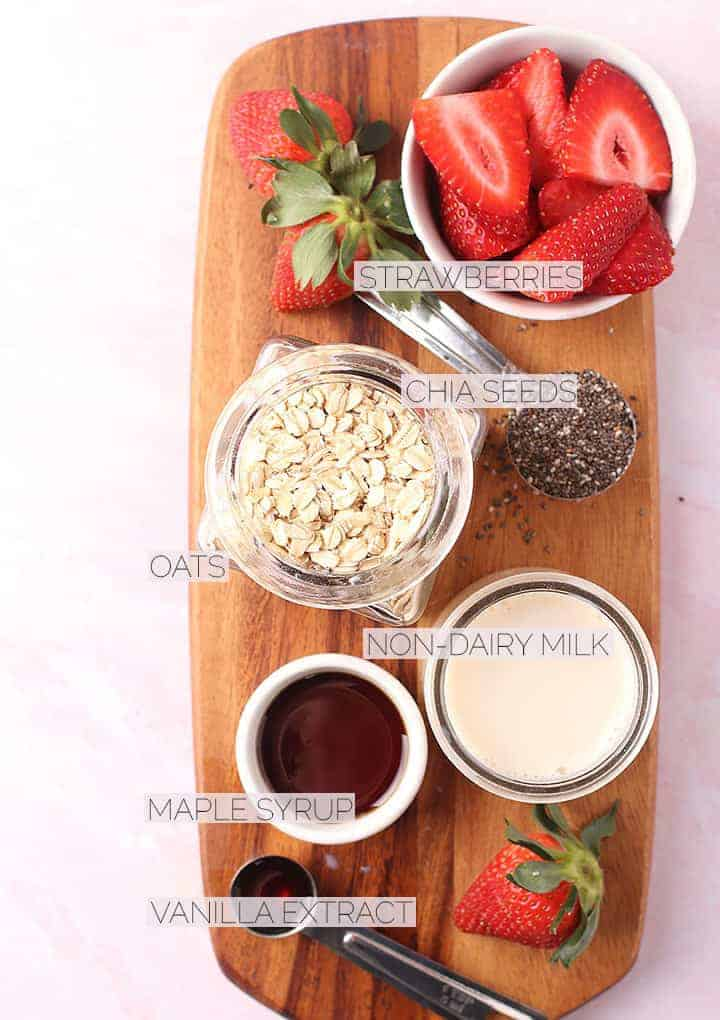 Ingredients for overnight oats on a wooden board