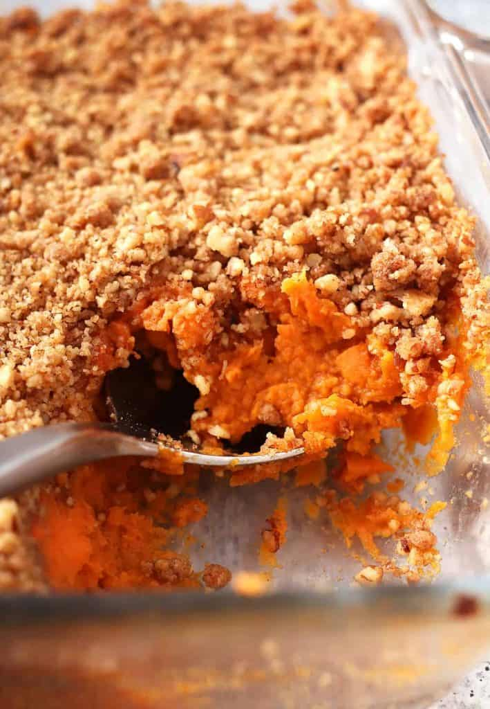 Finished sweet potato casserole in a glass dish