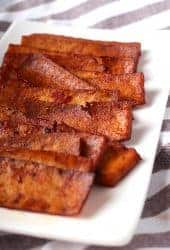 Strips of vegan bacon on a white plate