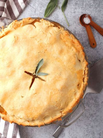 Whole finished pot pie with fresh sage