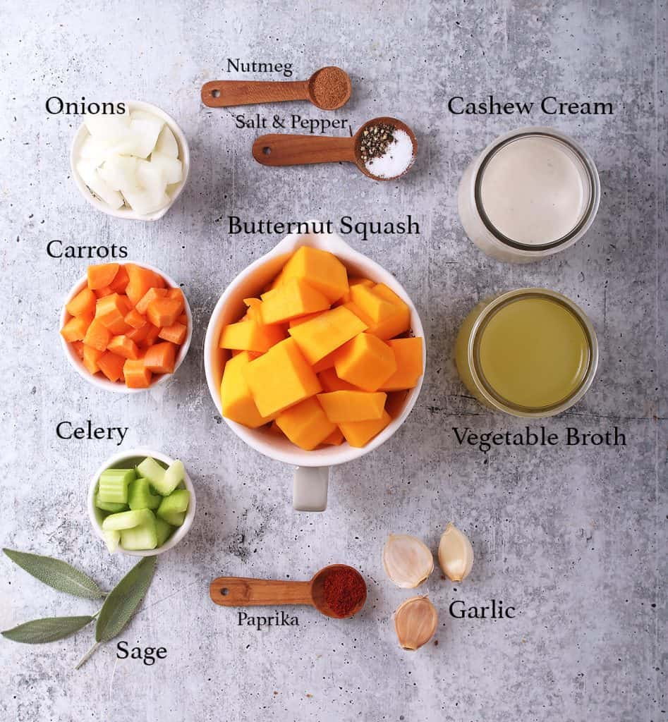 Ingredients for butternut squash soup on a concrete countertop
