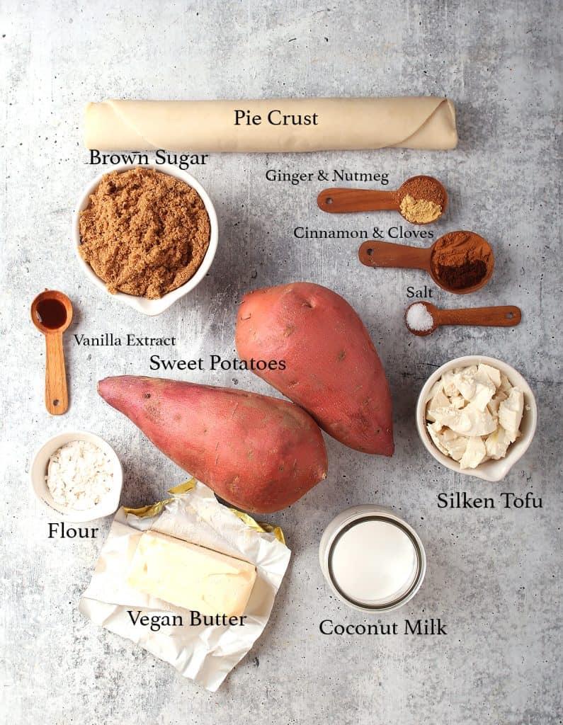 Ingredients for sweet potato pie on a concrete countertop