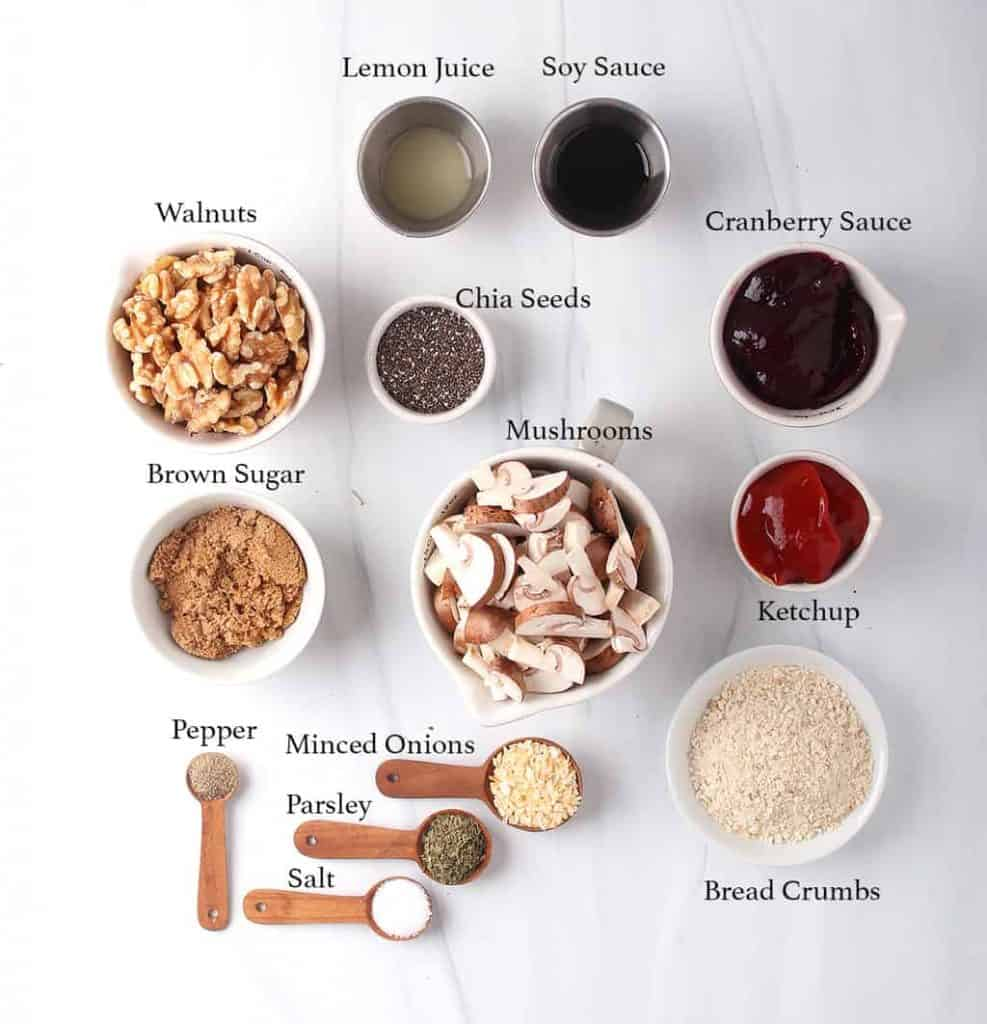 Ingredients for homemade meatballs measured out on a marble countertop