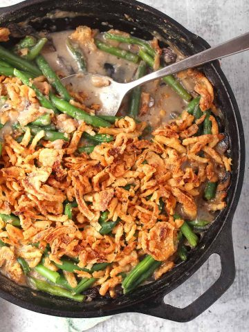 Finished green bean casserole in a cast iron skillet